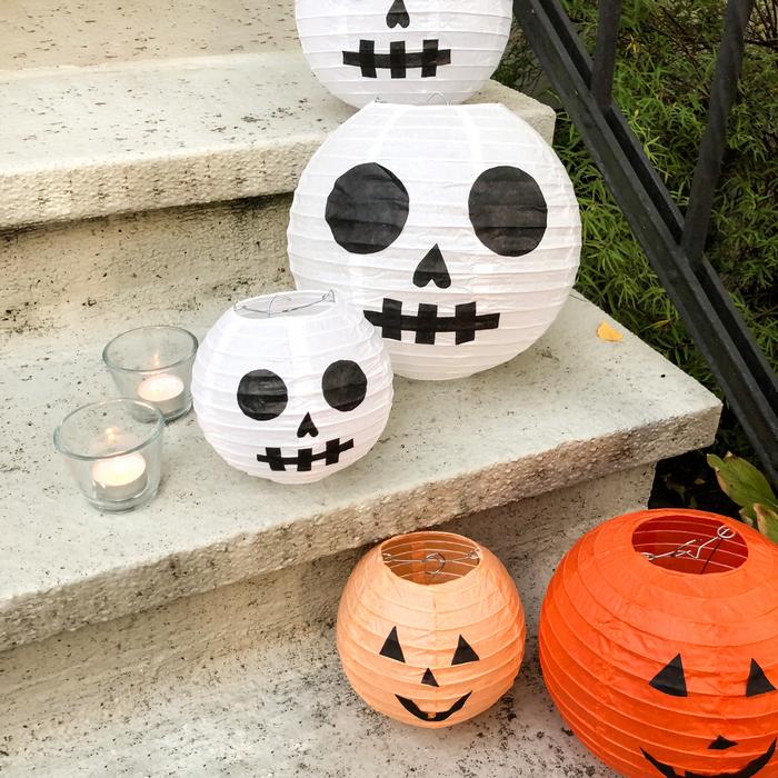 Halloween décor citrouille et squelette avec des lanternes en papier décorées