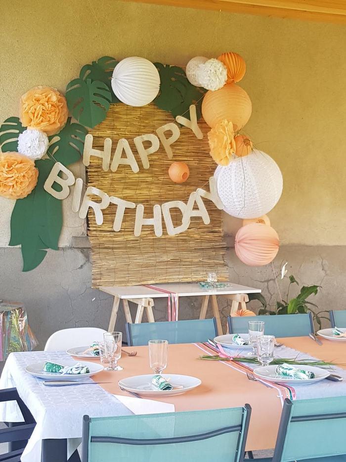 décoration anniversaire enfant dans les tons oranger, blanc et vert